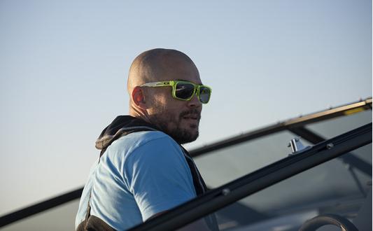 Man with sunglasses cruising.
