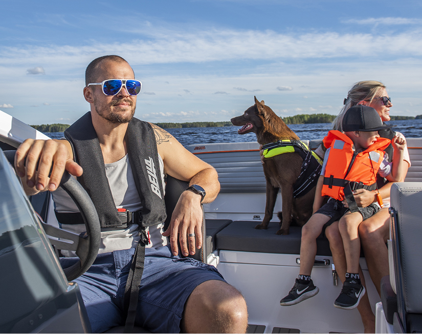 Family of three with dog in Bella boat.